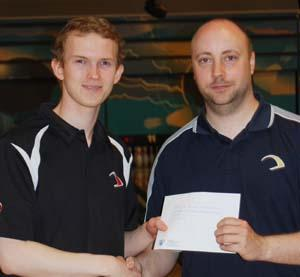 Larsen (left) receiving his $1k Ebonite prize from Aalborg house pro Michael Bai