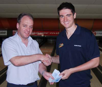 tournament manager Neil Dent (left) presents Marcus Berndt with his €100 squad leader prize