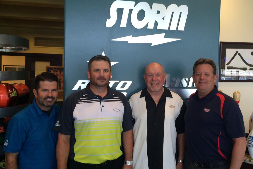 Dave Kost (second from left) is flanked by Storm Products Inc. executives Hank Boomershine, Bill Chrisman and Dave Symes after being named Public Relations Manager of Storm.