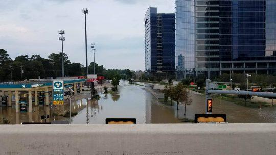 BJI contributor Mark London, a Houston resident, reported that two days ago the flood waters depicted here completely submerged the gas pumps at the gas station to the left.